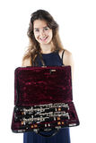Young woman shows clarinet in open case with velvet lining Royalty Free Stock Photo