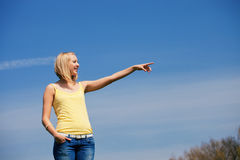 Young woman shows direction Stock Photography