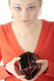 Young woman shows empty wallet Stock Images
