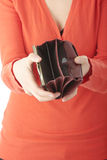 Young woman shows empty wallet Royalty Free Stock Image