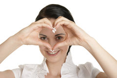 Young woman shows fingers heart symbol Royalty Free Stock Photo