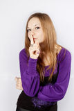 Young woman shows gesture silence Stock Image