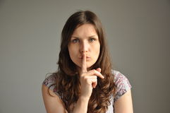 A young woman shows hash sign Royalty Free Stock Photo