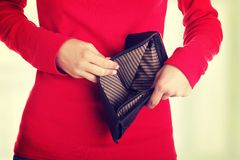 Young woman shows her empty wallet. Stock Photos