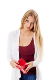 Young woman shows her empty wallet. Bankruptcy Royalty Free Stock Image