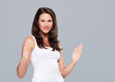Young woman shows large size with hands royalty free stock image