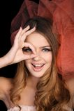 Young woman shows OK sign Royalty Free Stock Image