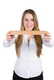 Young woman shows a ruler Royalty Free Stock Images