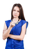 Young woman shows threaten fist. Strict beautiful woman shows threaten fist isolated on white royalty free stock photo