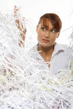 Young woman with shredded paper. Focus on face royalty free stock image