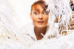 Young woman with shredded paper. Focus on face Stock Image