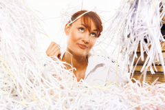 Young woman with shredded paper Royalty Free Stock Photography