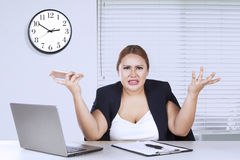 Young woman shrugs her shoulder Stock Photography