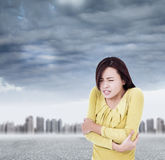 Young woman shudder and tightening body in outdoors Stock Photography