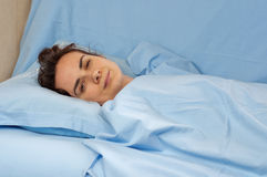 Young woman sick in bed Royalty Free Stock Images