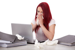 Young woman sick at work. Young beautiful woman is stressed, she has a cold and a lot of work to do Royalty Free Stock Photo