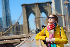 Young woman sightseeing on Brooklyn Bridge Royalty Free Stock Photo