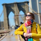 Young woman sightseeing on Brooklyn Bridge Royalty Free Stock Photography