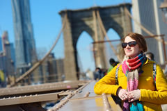 Young woman sightseeing on Brooklyn Bridge Royalty Free Stock Photos