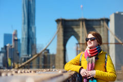 Young woman sightseeing on Brooklyn Bridge Stock Photo