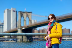 Young woman sightseeing by Brooklyn Bridge Royalty Free Stock Photography