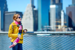 Young woman sightseeing by Brooklyn Bridge Royalty Free Stock Images