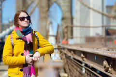 Young woman sightseeing on Brooklyn Bridge Stock Image