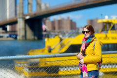 Young woman sightseeing by Brooklyn Bridge Stock Photos