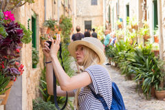 Young woman sightseeing and photographing. On street Royalty Free Stock Photography