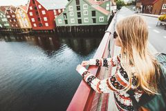 Young woman sightseeing Trondheim city from bridge Stock Photo