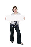 Young woman and sign. A young caucasian woman holding a blank sign for your message Stock Photography