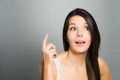 Young woman signaling with her index finger Royalty Free Stock Photography