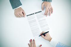 Young woman signing a divorce decree document Stock Photos