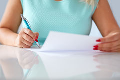Young woman signs a contract Stock Photography