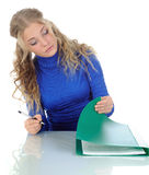 Young woman signs documents. Royalty Free Stock Photography