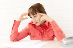 Young businesswoman sitting watching strictly with documents royalty free stock photography