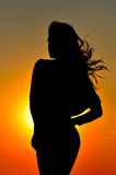 Young woman silhouette. At sunset Royalty Free Stock Image