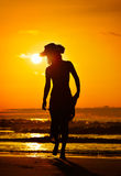 Young woman silhouette on the beach in summer Stock Photo