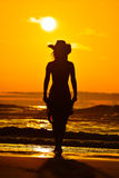 Young woman silhouette on the beach in summer Royalty Free Stock Photo