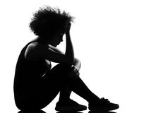 Young woman silhouette sit on the floor sadness Stock Photography