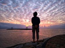 Free Young Woman Silhouette Standing On Beach Looking At The Dramatic Sunrise Sky View. Stock Photography - 159304212