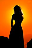 Young woman silhouette at sunset Royalty Free Stock Images
