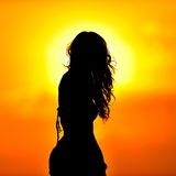 Young woman silhouette at sunset Stock Photo