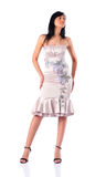 Young woman in silver dress Royalty Free Stock Image