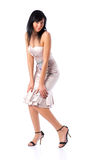 Young woman in silver dress Stock Images