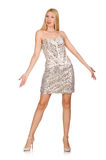 The young woman in silver dress isolated on white Stock Photography