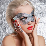 Young woman in silver mask Royalty Free Stock Images