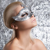 Young woman in silver mask Stock Image