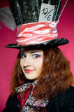 Young woman in the similitude of the Hatter Royalty Free Stock Photo