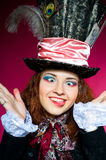 Young woman in the similitude of the Hatter Royalty Free Stock Photos
